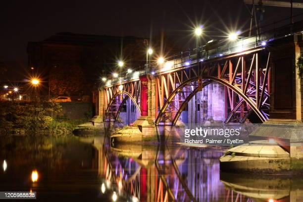 illuminated bridge over river in city at night - glasgow green stock pictures, royalty-free photos & images