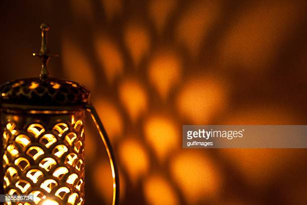 Illuminated bronze metallic lantern with lattice pattern