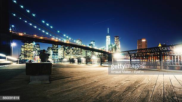Illuminated Brooklyn Bridge By City Against Clear Sky At Night