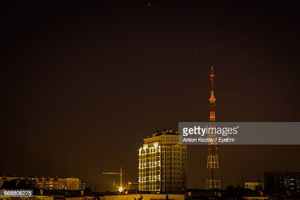 Illuminated Building And Communications Tower At Night