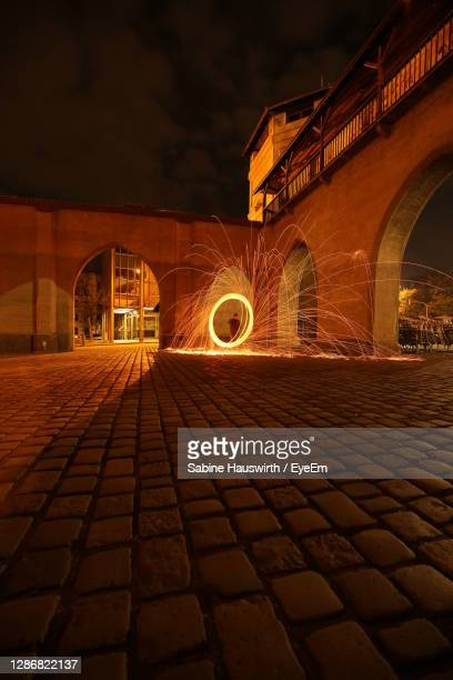 illuminated building at night - sabine hauswirth stock pictures, royalty-free photos & images
