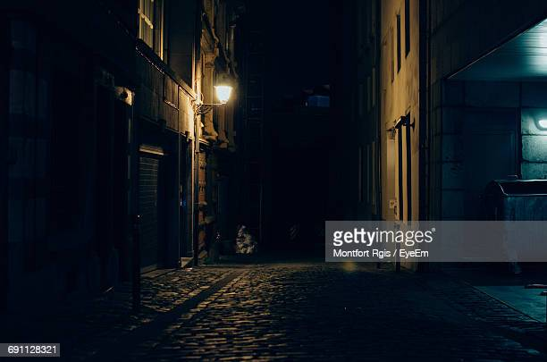 illuminated building at night - alley stock photos and pictures