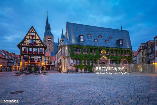 illuminated building by street against sky at dusk - saxony anhalt stock pictures, royalty-free photos & images