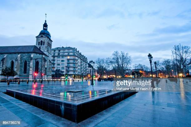 illuminated buildings against cloudy sky - rhone alpes stock photos and pictures