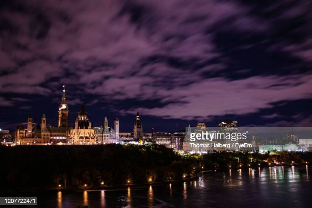 illuminated buildings against sky at night - ottawa stock pictures, royalty-free photos & images