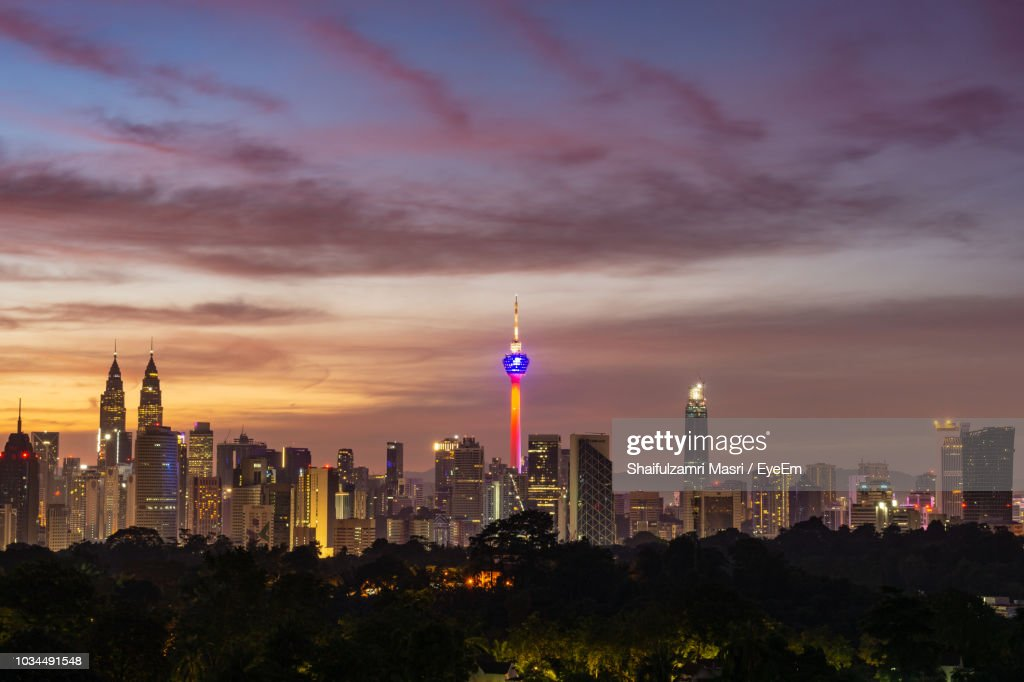 Illuminated Buildings Against Sky During Sunset : Stock Photo
