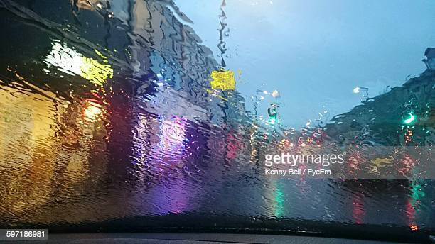 Illuminated Buildings Against Sky Seem From Wet Car Windshield During Monsoon