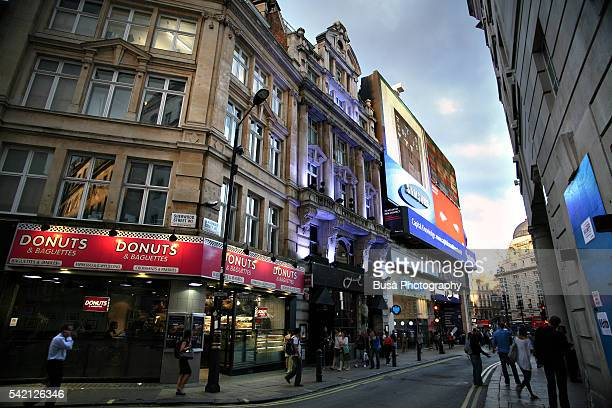illuminated buildings along glasshouse street, a side streets of piccadilly circus in london, england - camden london stock pictures, royalty-free photos & images