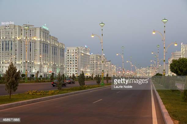 illuminated buildings, ashgabat, turkmenistan - ashgabat stock pictures, royalty-free photos & images