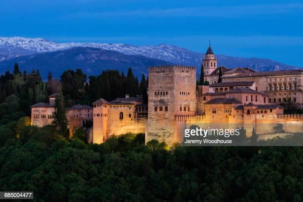 Illuminated buildings at dusk, Granada, Andalucia, Spain