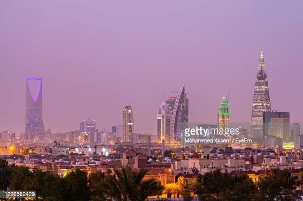 illuminated buildings in city against clear sky - saudi arabia stock pictures, royalty-free photos & images