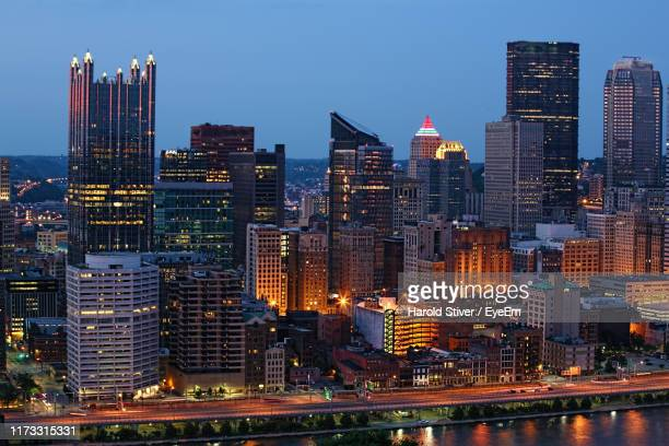 illuminated buildings in city against sky at dusk - washington dc stock pictures, royalty-free photos & images