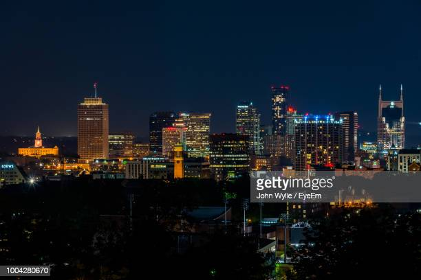 illuminated buildings in city against sky at night - nashville skyline stock pictures, royalty-free photos & images