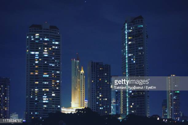 illuminated buildings in city against sky at night - muş city turkey stock pictures, royalty-free photos & images