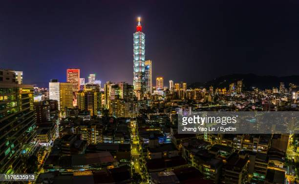 illuminated buildings in city against sky at night - taipei 101 個照片及圖片檔