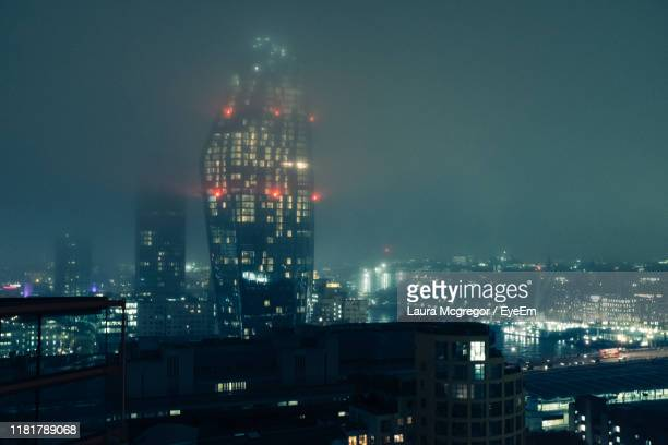 illuminated buildings in city against sky at night - mcgregor stock pictures, royalty-free photos & images