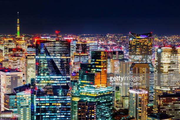 illuminated buildings in city against sky at night - roppongi hills stock pictures, royalty-free photos & images