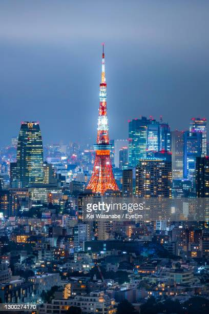 illuminated buildings in city against sky at night - tokyo japan stock pictures, royalty-free photos & images
