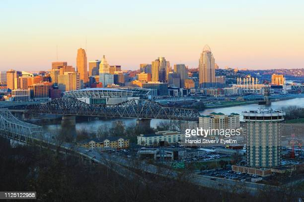 illuminated buildings in city against sky during sunset - cincinnati stock pictures, royalty-free photos & images