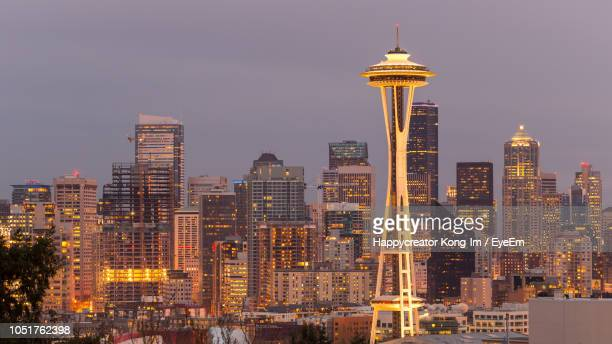 illuminated buildings in city against sky - washington state stock pictures, royalty-free photos & images