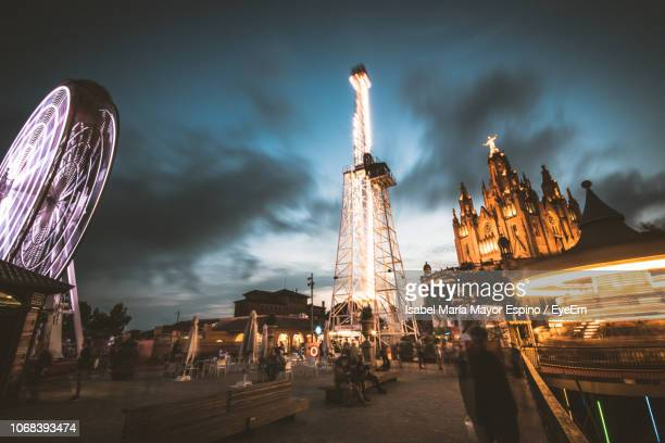 illuminated buildings in city against sky - tibidabo stock pictures, royalty-free photos & images