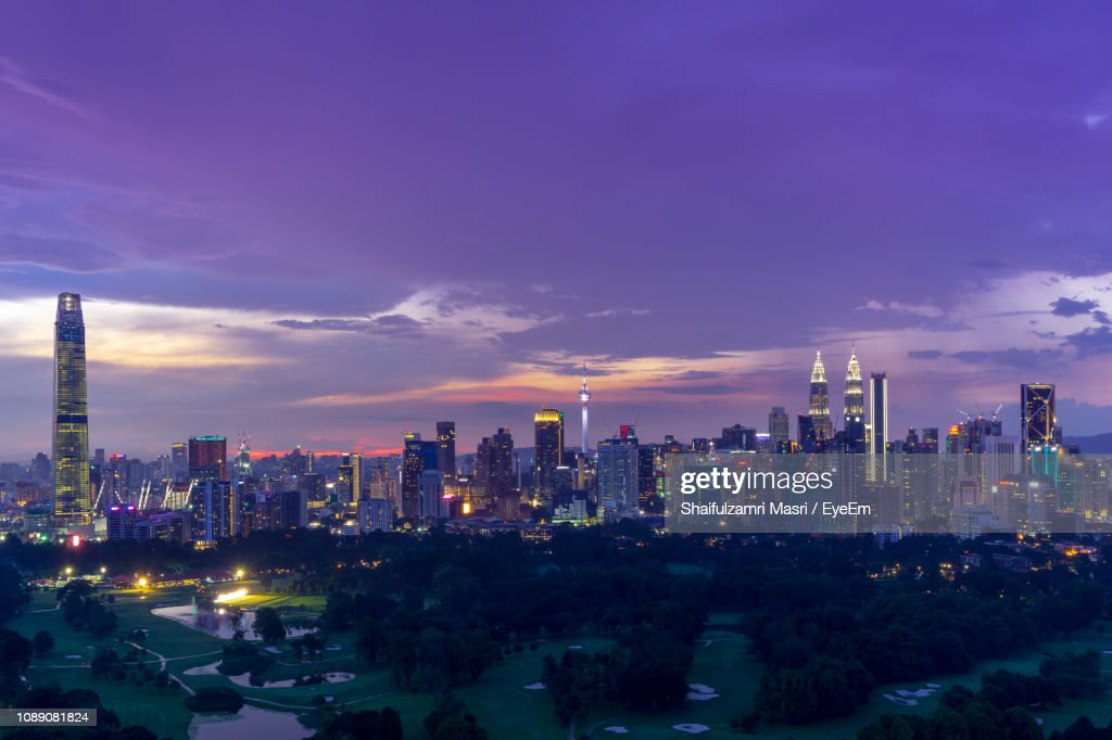 Illuminated Buildings In City Against Sky : Stock Photo