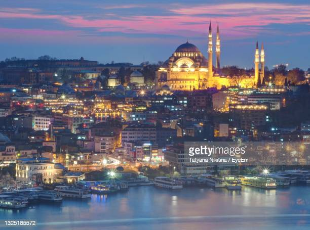 illuminated buildings in city at night in turkey istanbul - nikitina stock pictures, royalty-free photos & images
