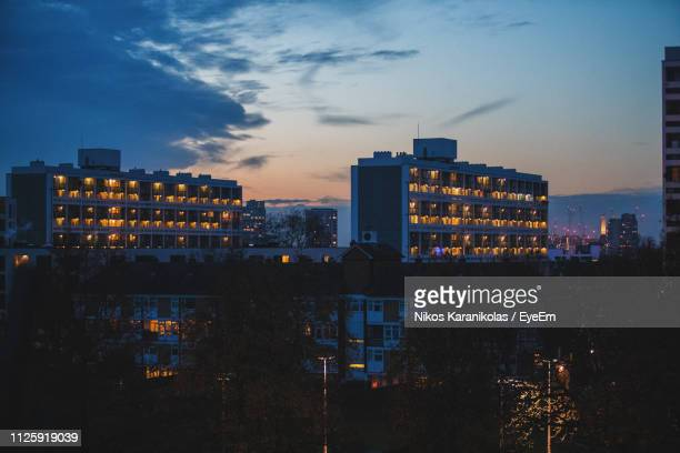 illuminated buildings in city at night - brixton stock photos and pictures