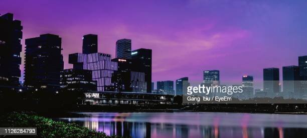 illuminated buildings in city at night - liu he stock pictures, royalty-free photos & images