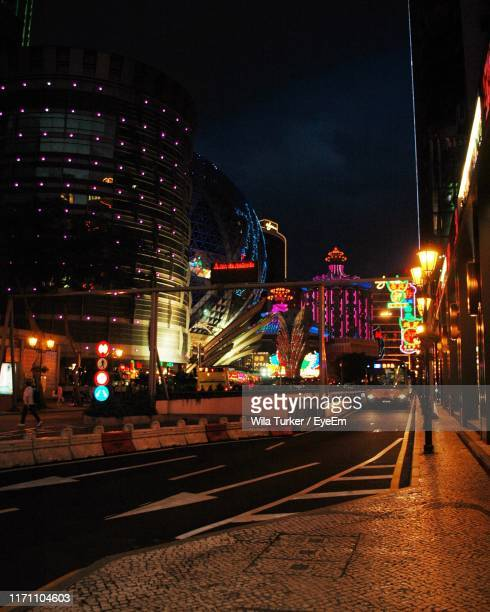 illuminated buildings in city at night - macao stock pictures, royalty-free photos & images