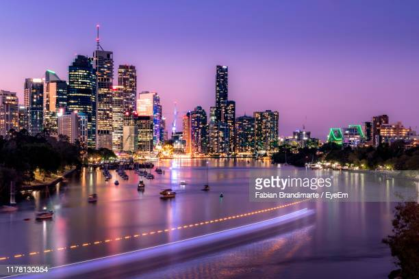 illuminated buildings in city at night - brisbane stock pictures, royalty-free photos & images