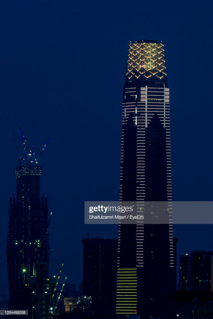 Illuminated Buildings In City At Night : Stock Photo