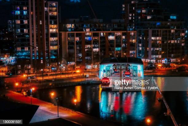 illuminated buildings in city at night - the o2 england stock pictures, royalty-free photos & images