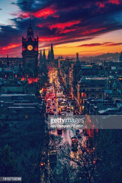 illuminated buildings in city during sunset - night stock pictures, royalty-free photos & images