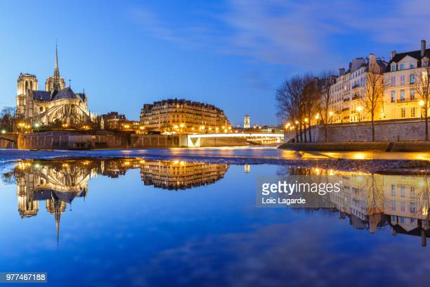illuminated buildings reflected in canal, loic lagarde, france - lagarde stock pictures, royalty-free photos & images