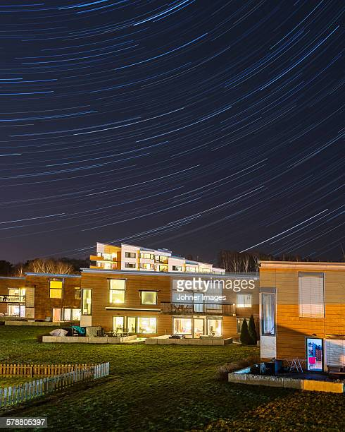 Illuminated buildings with star trails