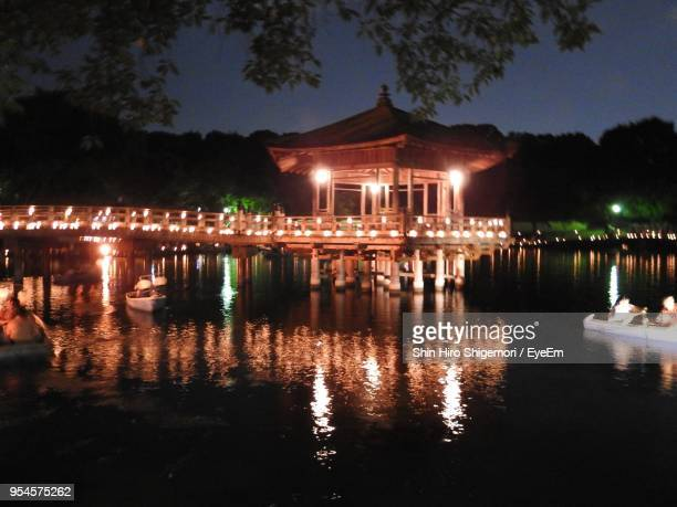 Illuminated Built Structure With Reflection In Water