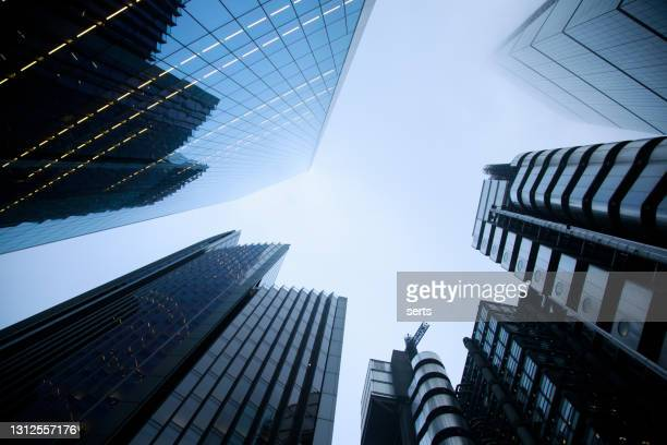 illuminated business towers in london, united kingdom - london stock pictures, royalty-free photos & images