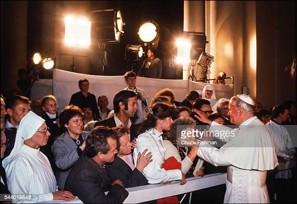 Illuminated by spotlights Pope John Paul II blesses people in Katowice Cathedral Katowice Poland June 20 1983