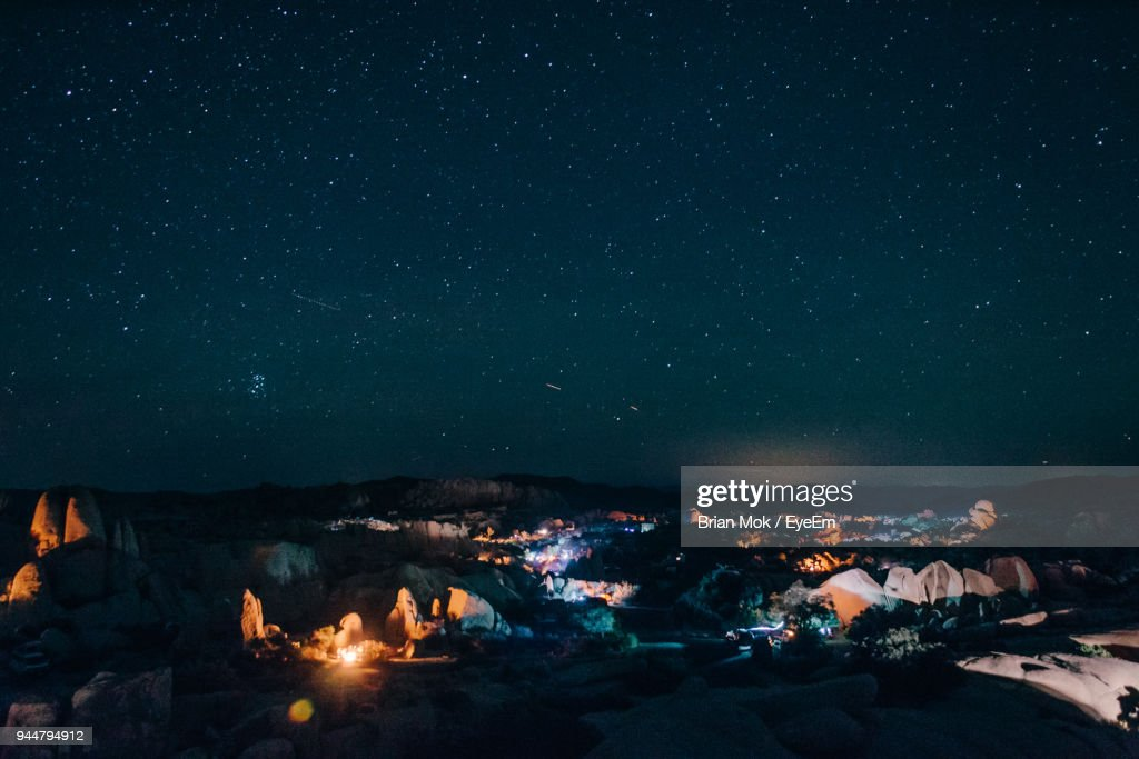 Illuminated Camping Grounds Against Sky At Night : Stock Photo