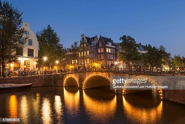 Illuminated canal bridge, Amsterdam, Netherlands