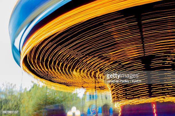 illuminated carousel at traveling carnival - light natural phenomenon stock photos and pictures