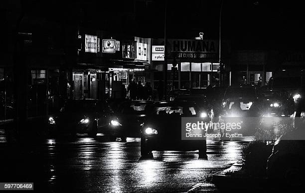 Illuminated Cars On Road At Night