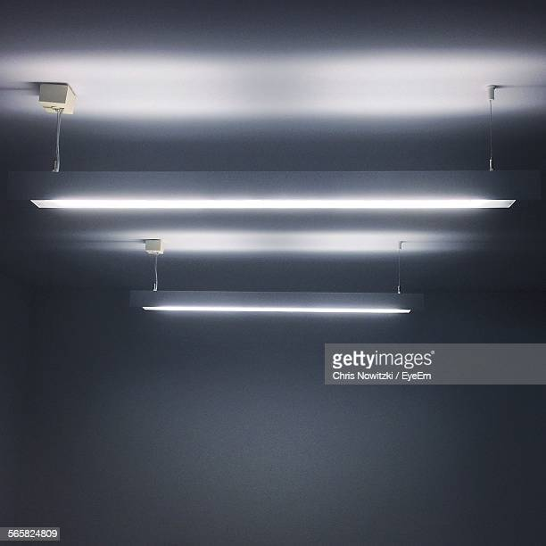 illuminated ceiling lamp - fluorescent light stock pictures, royalty-free photos & images