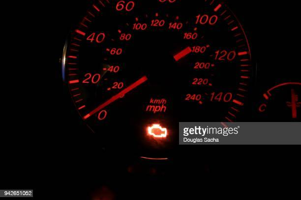 illuminated check engine light displayed on a vehicle dashboard - engine stock pictures, royalty-free photos & images