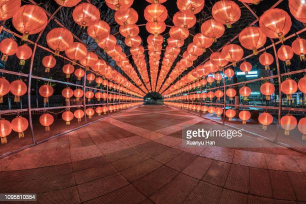 illuminated chinese lanterns hanging at night - vanishing point stock pictures, royalty-free photos & images