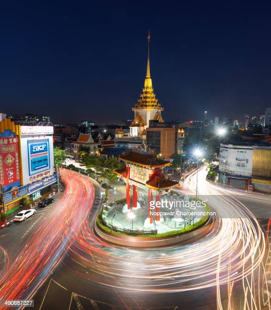 CONTENT] Illuminated Chinesestyled arch constructed in honor of His Majesty The King Rama IX at Yaowarat Bangkok Thailand Four Chinese characters...