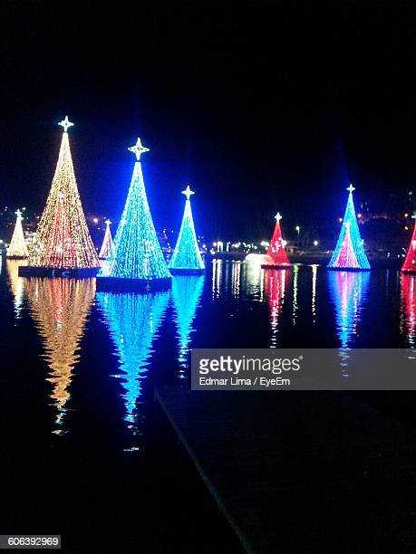 Illuminated Christmas Decoration In River At Night