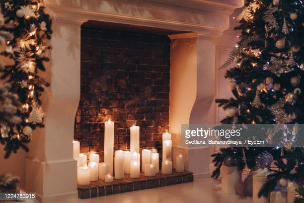 illuminated christmas tree at home - christmas decore candle stock pictures, royalty-free photos & images