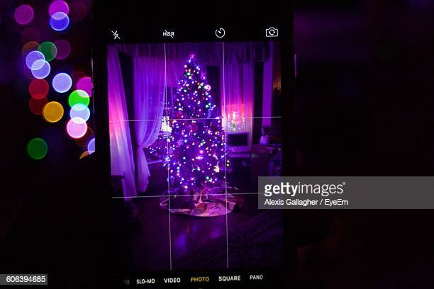 Illuminated Christmas Tree At Home Seen On Mobile Screen